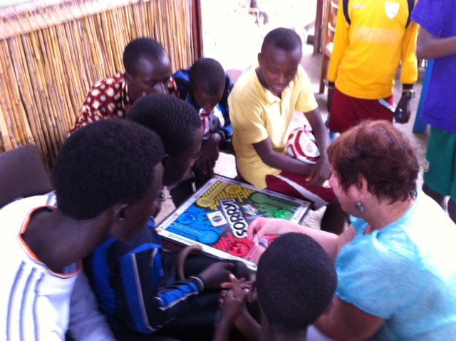 showing the children how to play sorry.